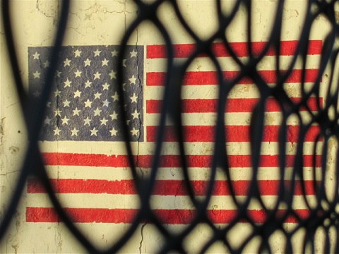 FlagBehindBars.ChrisGoldNY.Flickr