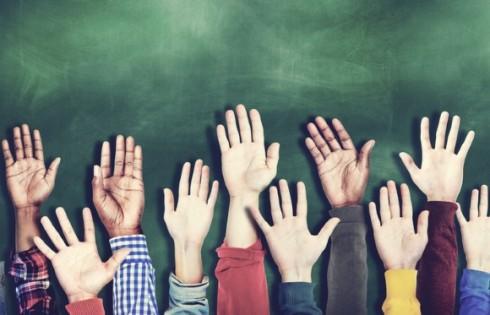 ClassroomHands.Shutterstock